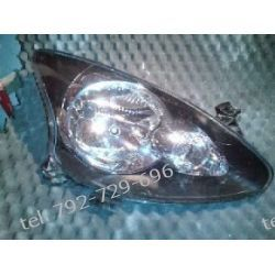 Toyota Aygo prawa lampa przód + silniczel, brak 1 uchwytu Pozostałe