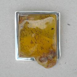 broszka ze srebra i bursztynu