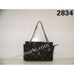 Torba marki Chanel wykonana ze skóry ,elegancka torba dla eleganckiej kobietyi