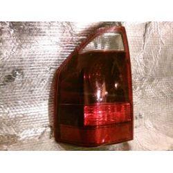 Mitsubishi Pajero 2005 lampa tylna lewa góra uchwyty całe