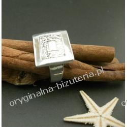 Srebrny pierścionek z pazurem