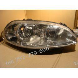 Fiat Croma prawa lampa przód, uchwyty mocujące uszkodzone