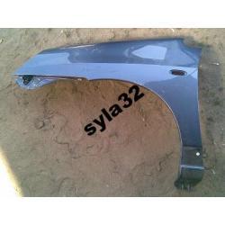 Błotnik lewy Suzuki Liana 2004-