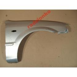 Błotnik przedni prawy Mazda 323 2001-2003 Drzwi