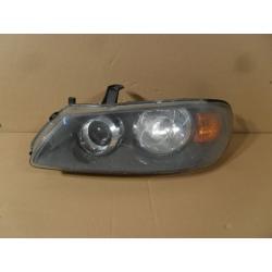 Reflektor lewy Nissan Almera N16 2003-...