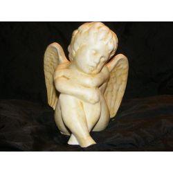 Siedzący i drzemiący anioł Prace ręczne