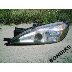 Reflektor lewy Primera P11 1999-2001(po liftingu)
