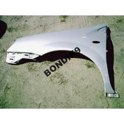 Błotnik lewy plastik Nissan Almera Tino 2001-2007