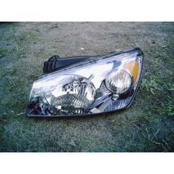 Reflektor lewy (manualny) Kia Cerato rok 2004-2006 Poduszki powietrzne