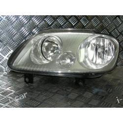 VW Caddy lewy reflektor lampa