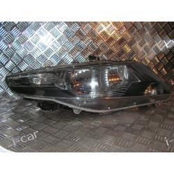 Honda City prawy reflektor ORYGINAŁ