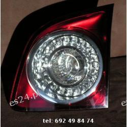 GOLF V 5 PLUS prawa lampa HELLA w klape
