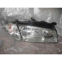 Mazda 626 reflektor pawy ORYGINALNY