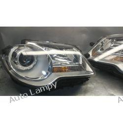 VW CADDY TOURAN KOMPLET ORYGINALNYCH LAMP  Lampy przednie