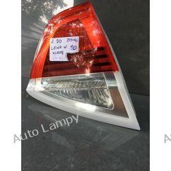 BMW E90 LEWA LAMPA W KLAPE Motoryzacja