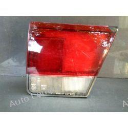 MAZDA 626 4 PRAWA LAMPA W KLAPE Lampy przednie